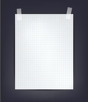 Arkusz papieru a4 w kratkę z taśmą na ciemnym tle, bliska ilustracji białej notatki