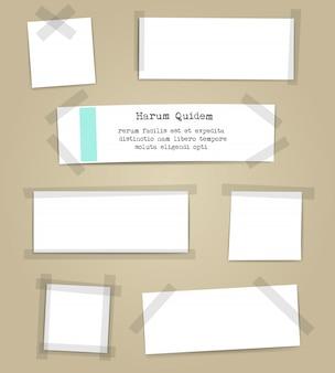 Arkusze papieru z kawałkami taśmy klejącej