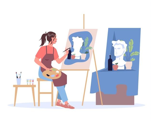 Artystka siedzi przy sztalugach i maluje. młody malarz z paletą. twórczy zawód.