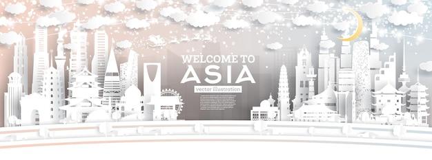 Asia city skyline w stylu paper cut z płatkami śniegu, księżycem i neonową girlandą.