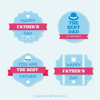 Asortyment niebieski naklejek z różowymi wstążkami na dzień ojca