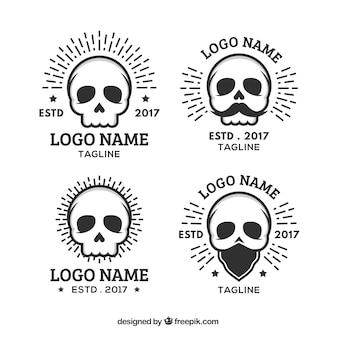 Asortyment płaskich logo czaszki