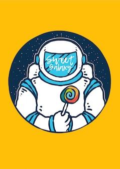 Astronauta trzyma cukierki z galaktyką i wszechświatem