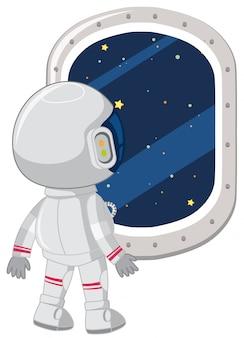 Astronauta wygląda przez okno