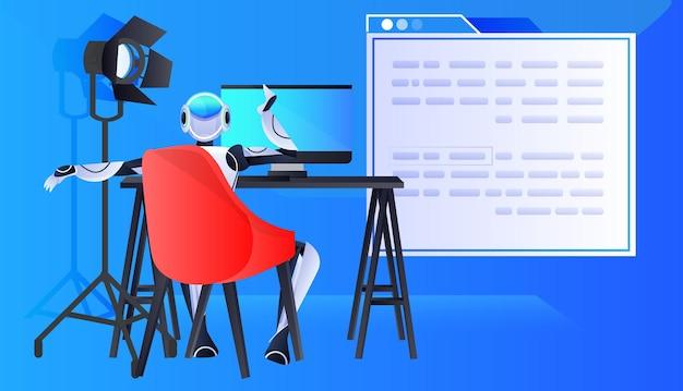 Asystent chatbota robota siedzący w miejscu pracy i pracujący nad komputerową komunikacją online sztuczną inteligencją