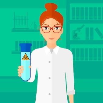 Asystent laboratoryjny z probówką.