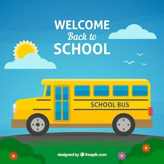 Autobus szkolny w słoneczny dzień z płaskim wystrojem