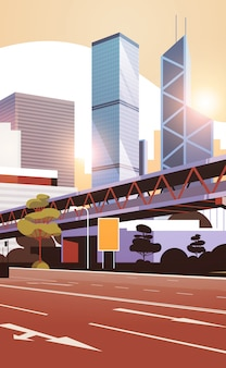 Autostrada droga do panoramę miasta z nowoczesnymi drapaczami chmur i metrem