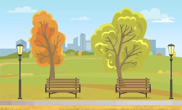 Autumn city park z ławkami i latarnią uliczną