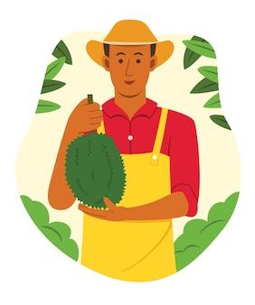 Azjatycki farmer trzyma durian