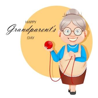 Babcia postać z kreskówki trzyma piłkę wełny