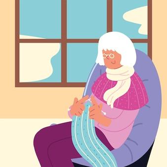 Babcia robi na drutach w domu