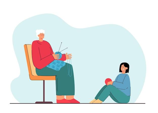Babcia siedzi i robi na drutach obok wnuczki. płaska ilustracja