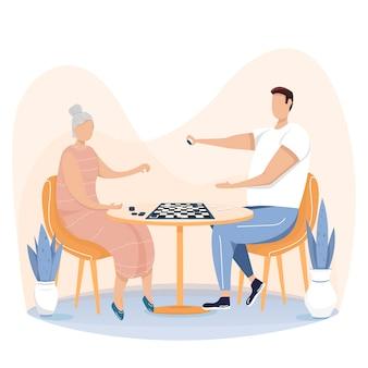 Babcia, stara kobieta gra w szachy z wnukiem, koncepcja szczęśliwa rodzina. ludzie grający w grę planszową.