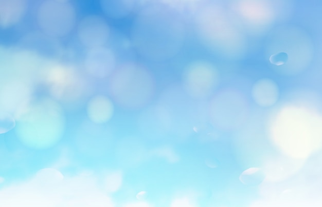 Bąbelki bokeh i słońce migoczą na niebieskim tle