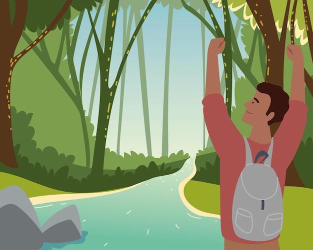 Backpacker w leśnych drzewach rzecznych