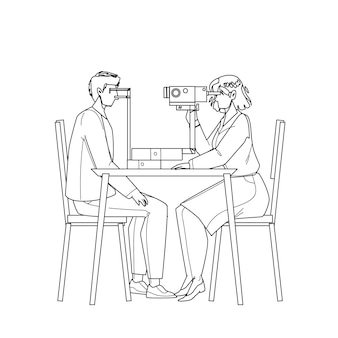 Badanie wzroku pacjenta w gabinecie lekarskim