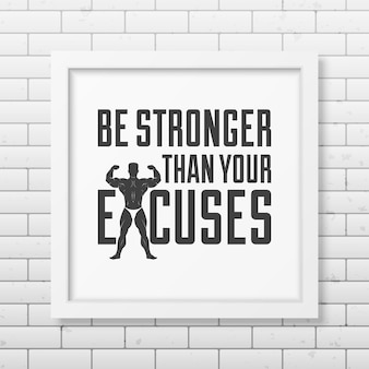 Bądź silniejszy niż wymówki - podaj typografię w realistycznej kwadratowej białej ramce na ścianie z cegły