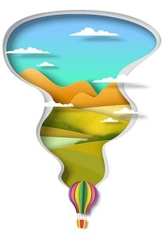 Balon na ogrzane powietrze lecący nad zielonymi wzgórzami i rzeką wektor wycięty papier ilustracja podróże lato wakacje...