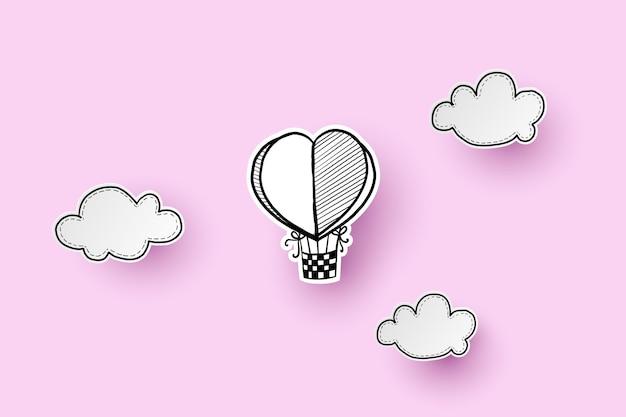 Balon na ogrzane powietrze w kształcie serca na niebie. rysunek odręczny i wycinanka.