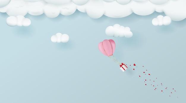 Balon na ogrzane powietrze w stylu cartoon latający z prezentem na walentynki