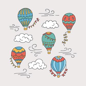 Balony na ogrzane powietrze i chmury. ręcznie rysowane wzór. ilustracja w stylu bazgroły