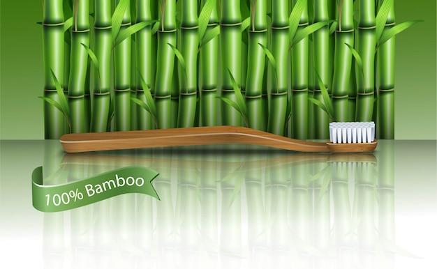Bambusowa szczoteczka do zębów na bambusowej roślinie. zero marnotrawstwa w stylu życia.