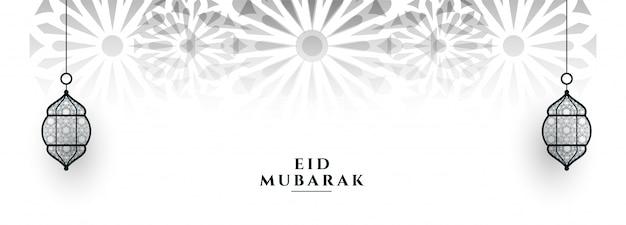 Baner festiwalowy eid mubarak z wiszącymi lampionami