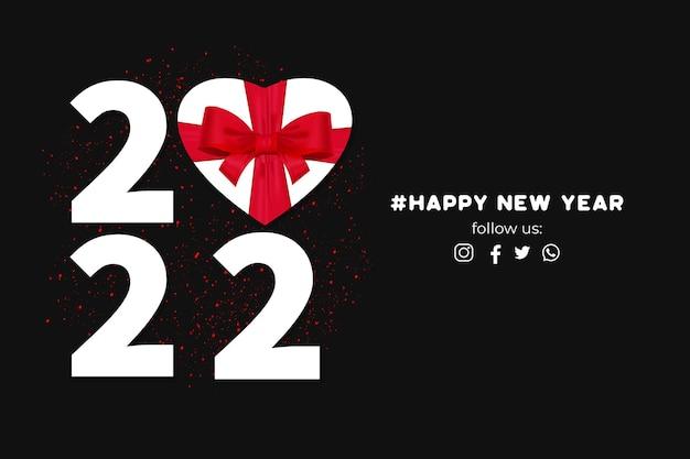 Baner szczęśliwego nowego roku 2022 z ramką w kształcie serca na prezent