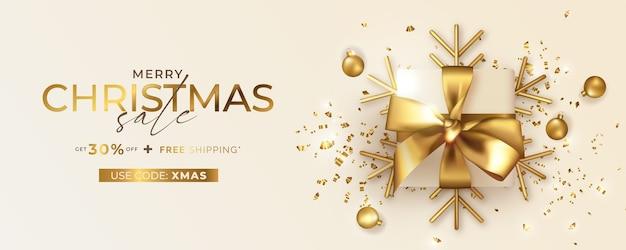 Baner wesołych świąt bożego narodzenia z kodem kuponu i realistycznym złotym prezentem