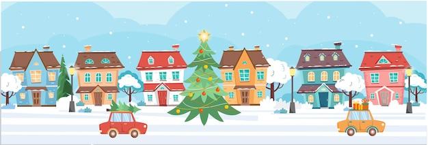 Baner z domami i choinką w zimowy dzień domki drzewa lampy uliczne samochody zimowe miasto