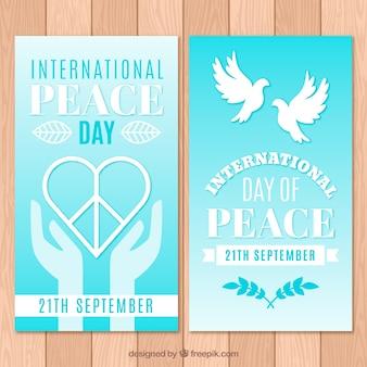 Banery na dzień pokoju z sercem i gołębi