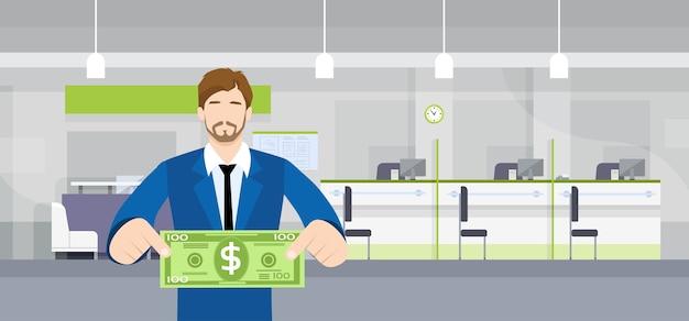 Bankowiec biznesowy mężczyzna chwyta sto dolarów banknotów pojęcie