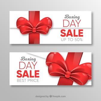 Banner sprzedaż dzień świąteczny z czerwoną wstążką