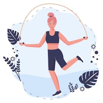 Bardzo młoda kobieta skoki z liny, ćwiczenia sportowe i ciała.