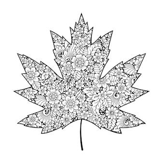 Bardzo szczegółowy kwiatowy wzór wykonany w stylu mehndi w postaci liścia klonu. ozdobny kwiat w etnicznym orientalnym, indyjskim stylu.