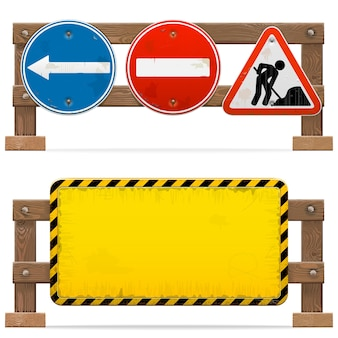 Bariery ze znakami drogowymi na białym tle