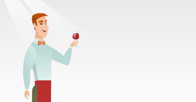 Barman trzyma kieliszek wina w ręku.