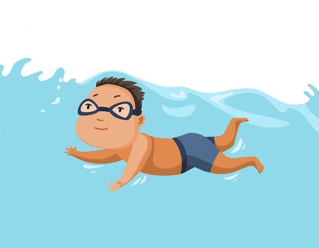 Basen dla dzieci. wesoły i aktywny mały chłopiec pływanie w basenie. chłopiec w strojach kąpielowych pływa w basenie dla dzieci. podwodny widok