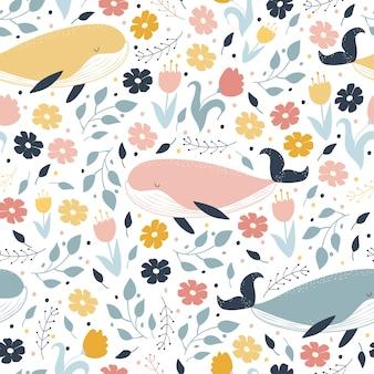 Bez szwu wzorów. wieloryby pływają w kwiatach. marzenia. ilustracja wektorowa
