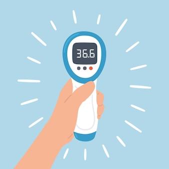 Bezdotykowy termometr elektroniczny na podczerwień z normalną temperaturą w dłoni. medyczna aparatura pomiarowa.