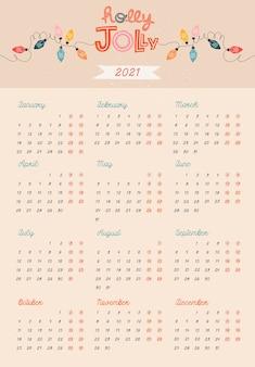Beżowy szablon kalendarza. ozdoby i ozdoby świąteczne.