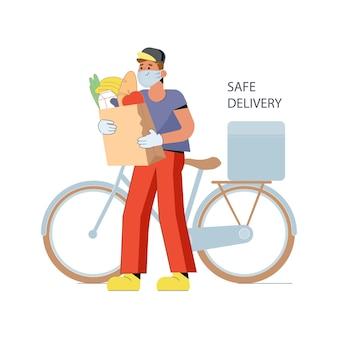 Bezpieczna dostawa jedzenia młody kurier nosi maskę na rowerze podczas dostarczania jedzenia