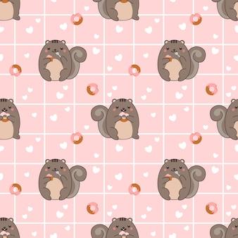 Bezszwowa deseniowa pyzata wiewiórka je pączek i babeczkę