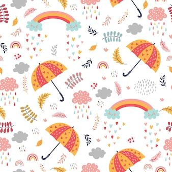 Bezszwowe jesień wzór z parasolami, chmurami z deszczem i tęczami.