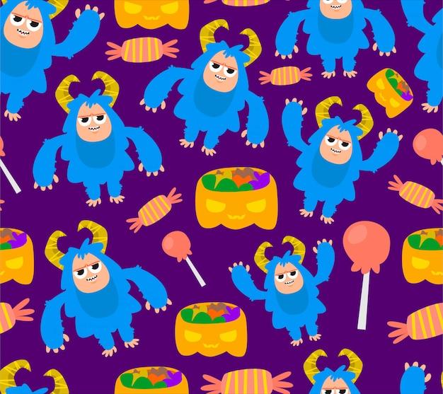 Bezszwowe niebieski charakter potwora i wzór cukierki