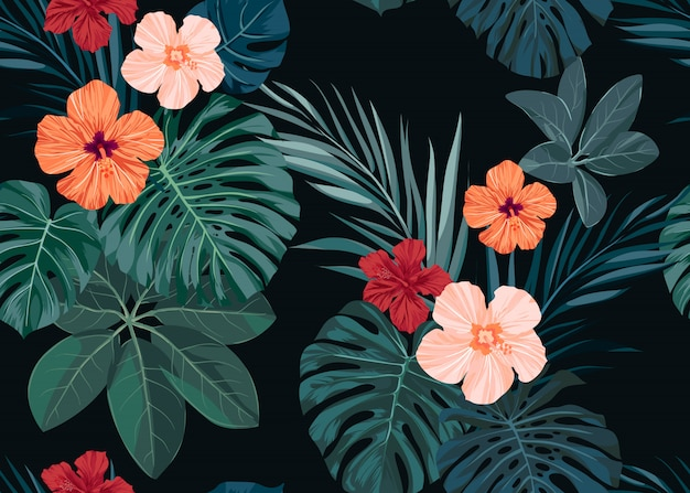 Bezszwowe ręcznie rysowane tropikalny wzór z kwiatów hibiskusa i egzotycznych liści palmowych na ciemnym tle.