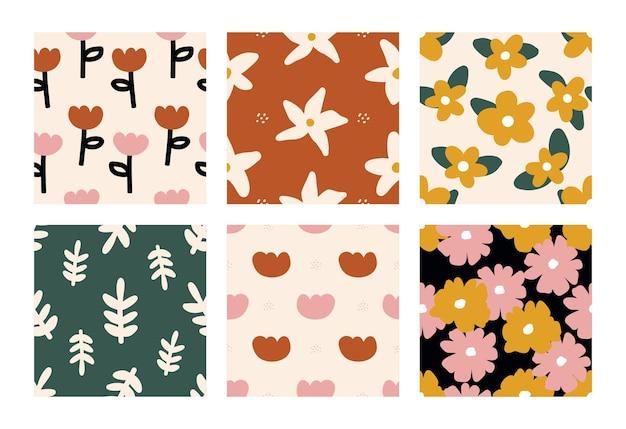 Bezszwowe ręcznie rysowane wzory kwiatów i liści