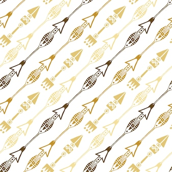 Bezszwowe tło etniczne strzałki w kolorach złota. ręcznie rysowane strzałki wektor wzór.