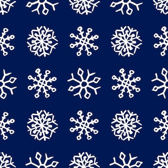 Bezszwowe tło ręcznie rysowane płatki śniegu. białe płatki śniegu na niebieskim tle. elementy dekoracji świątecznych i noworocznych. ilustracja wektorowa.